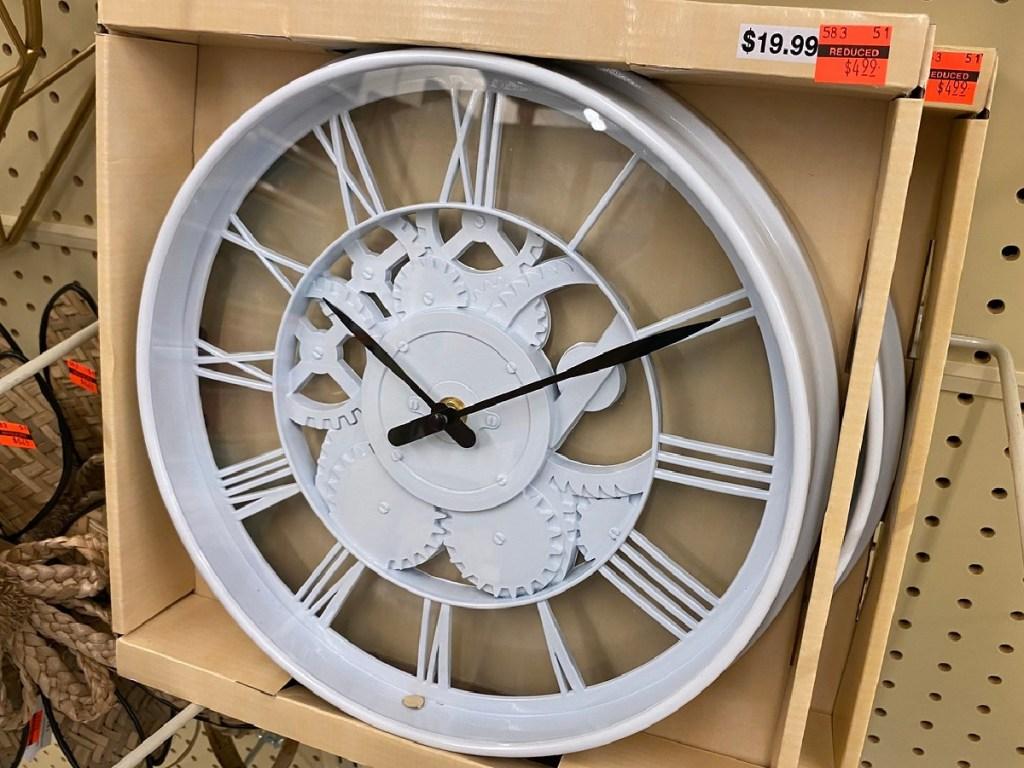 white clock in original box on display at store