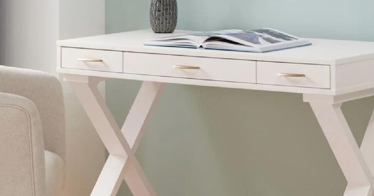 white desk with magazine on it