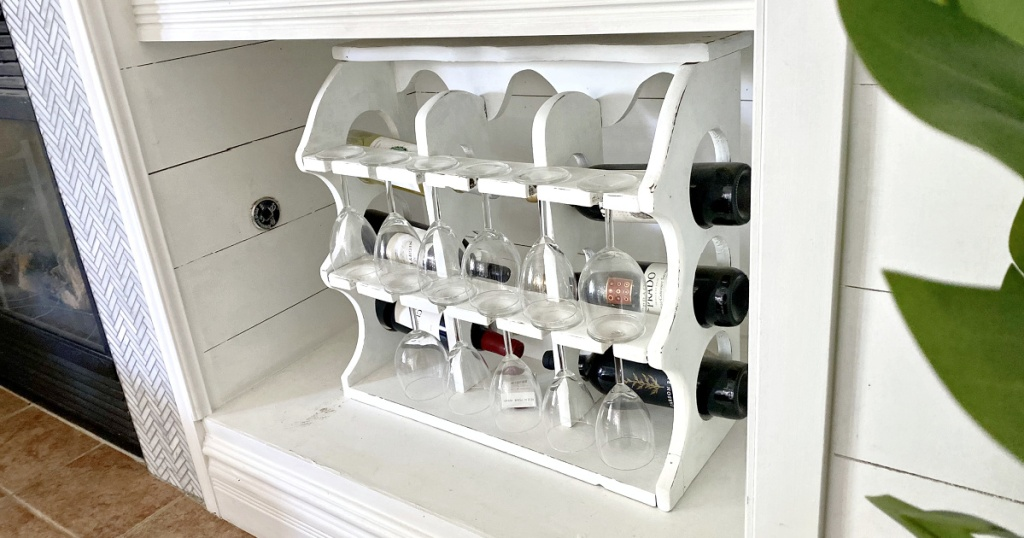 white wine rack with wine bottles