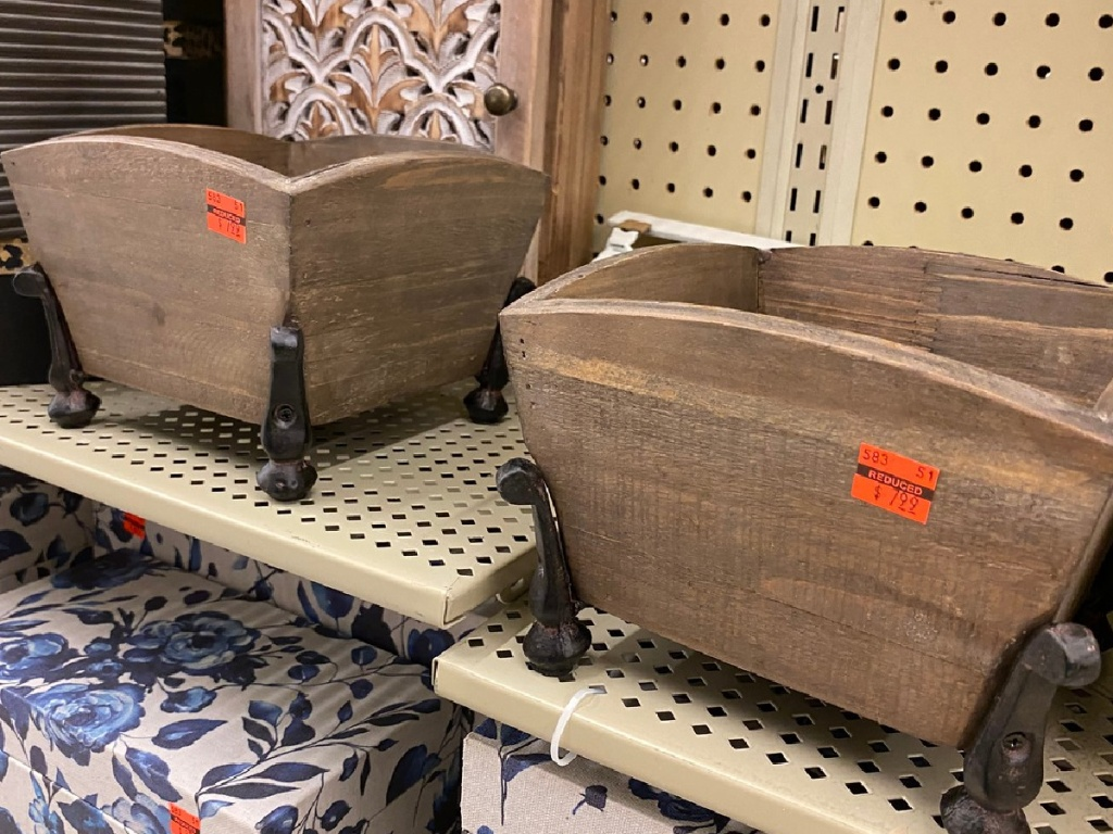 store display showing wooden boxes with prices on them