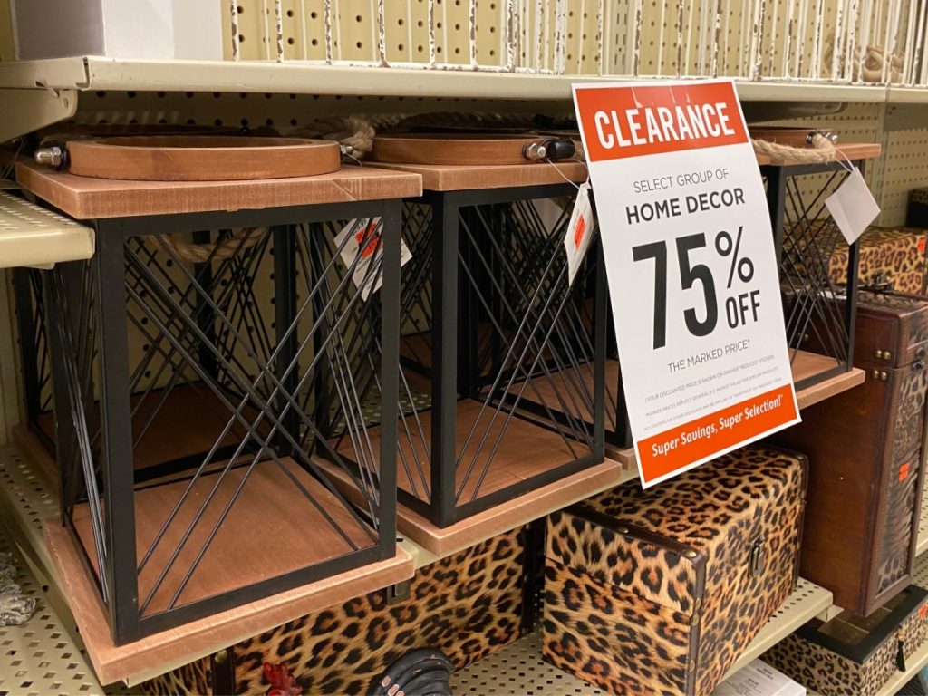 store shelf with wood laterns by clearance sign