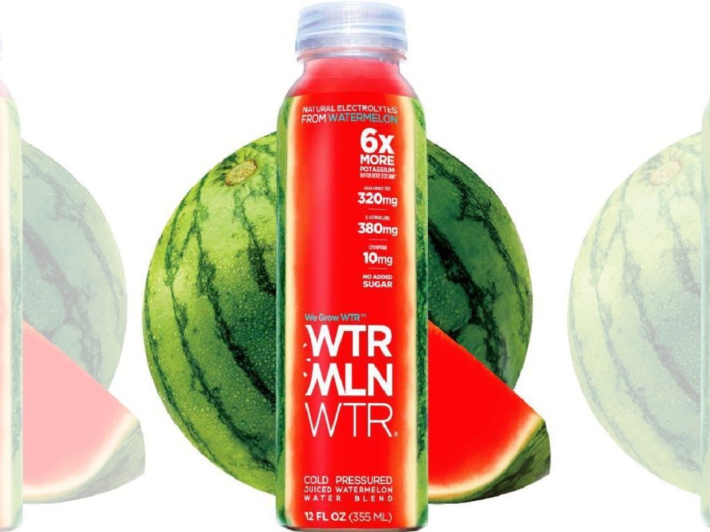 red water bottle sitting in front of a watermelon
