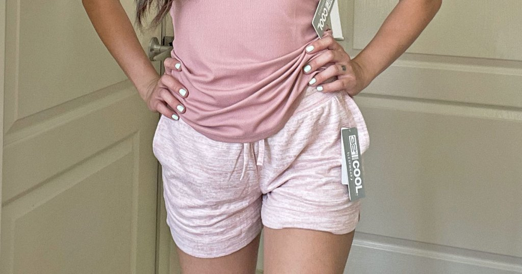 woman in pink tank top and shorts