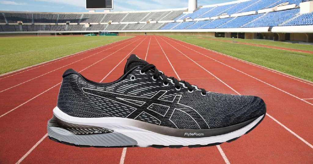 men's black and gray shoe and race track background