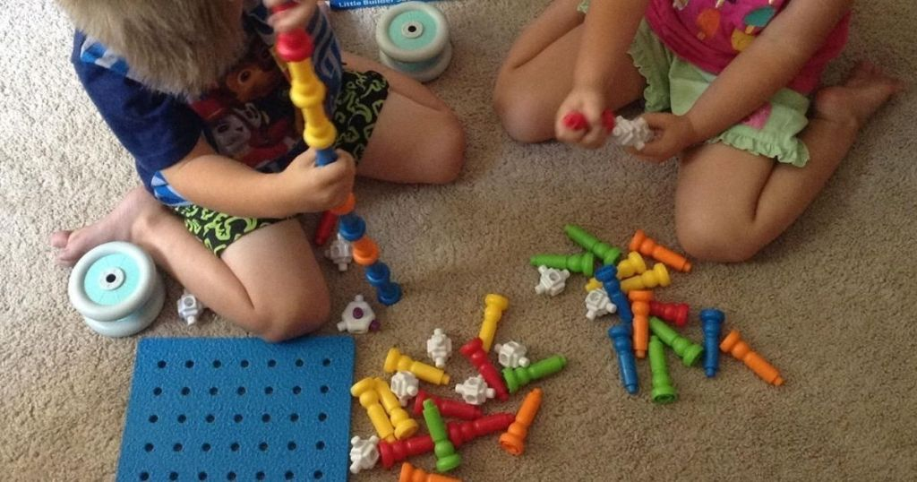 two kids playing with Action Stackers toys