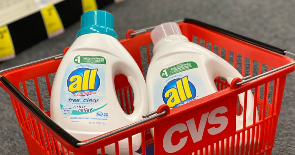 two white bottles of detergent in red basket