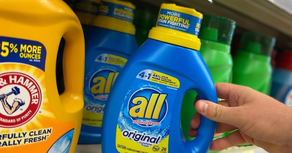 hand holding an All Laundry detergent bottle