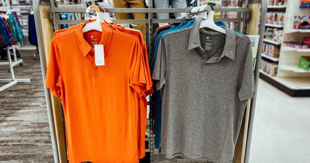orange and grey polo on rack