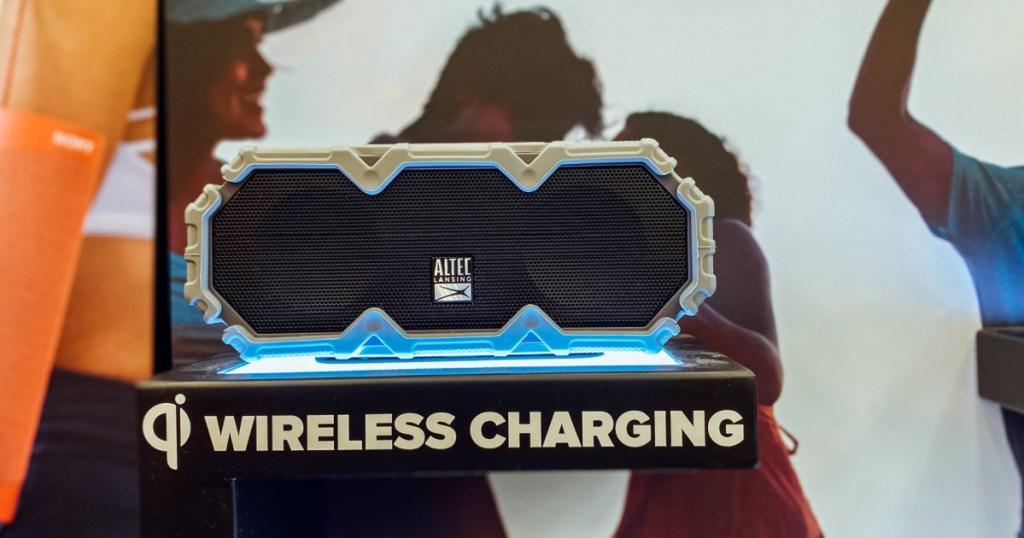 Black wireless speaker on shelf