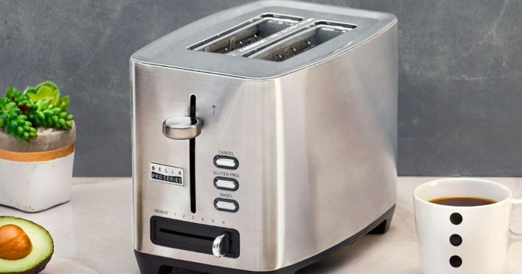 toaster sitting on a counter with coffee next to it