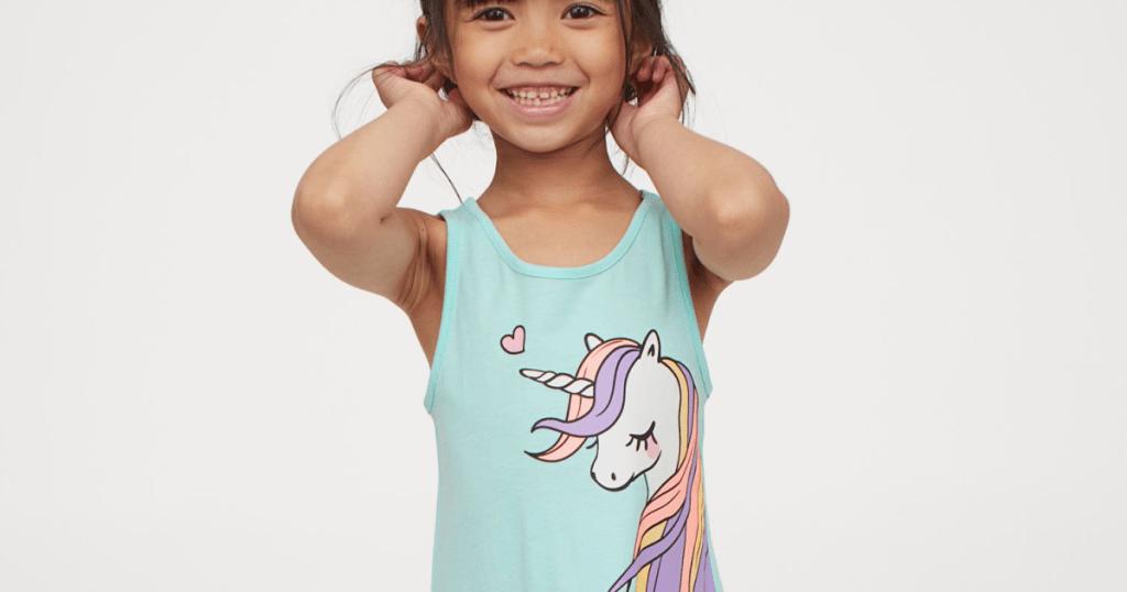 little girl wearing unicorn dress