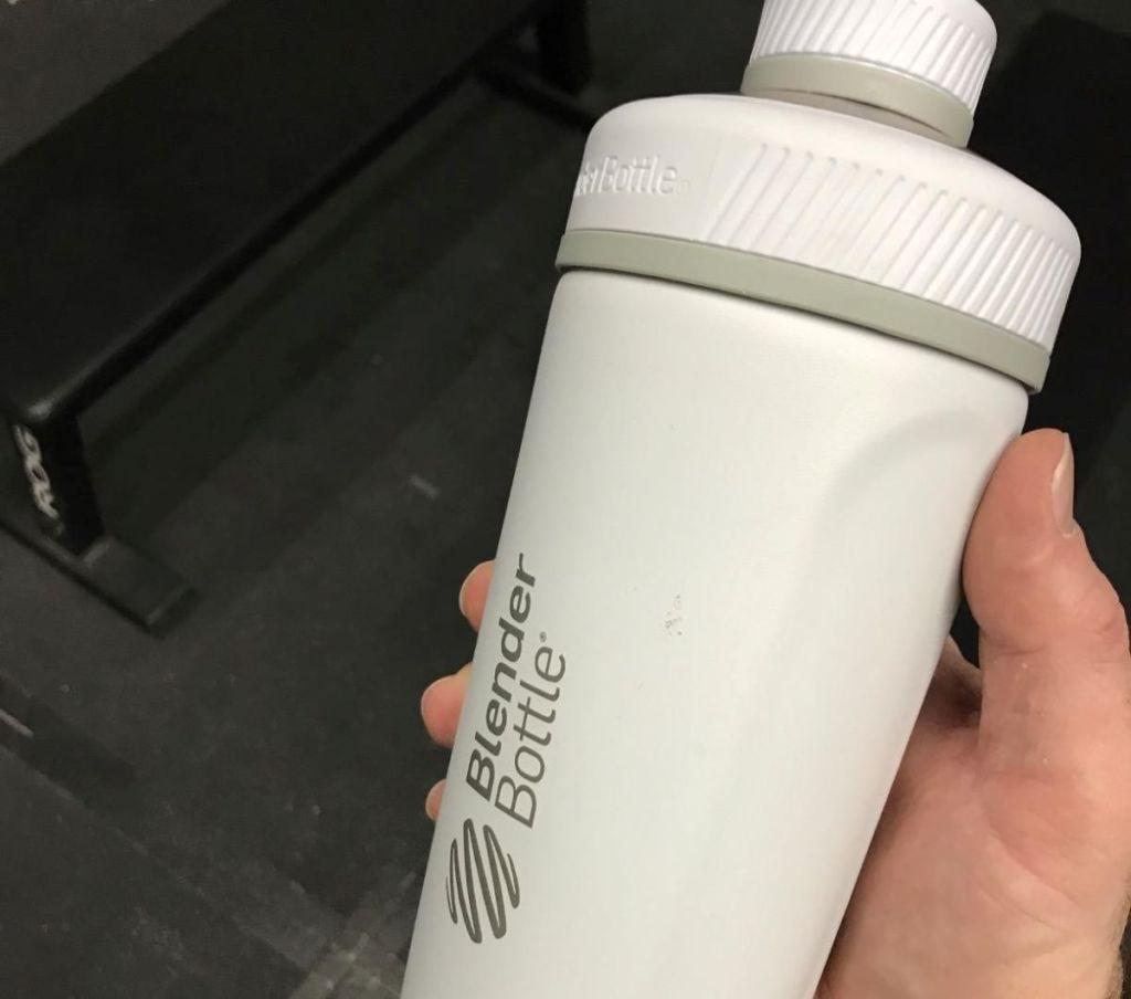 hand holding a white Blender Bottle