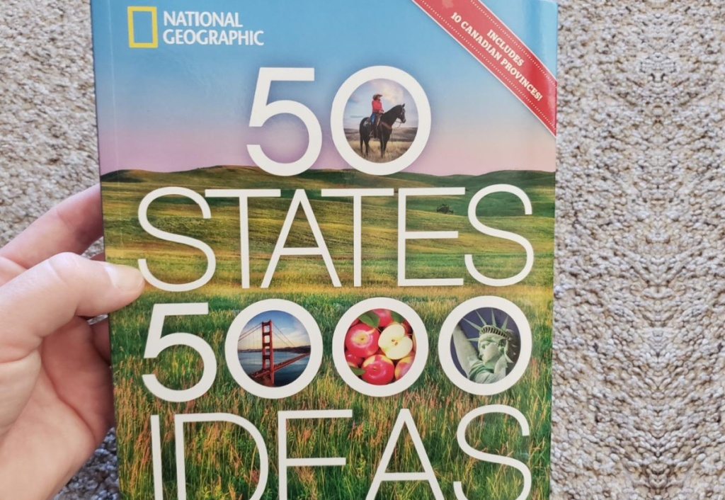 hand holding 50 states book