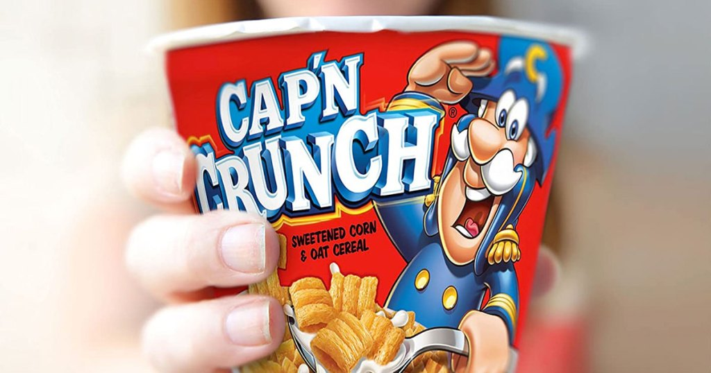 hand holding capn crunch cereal cup