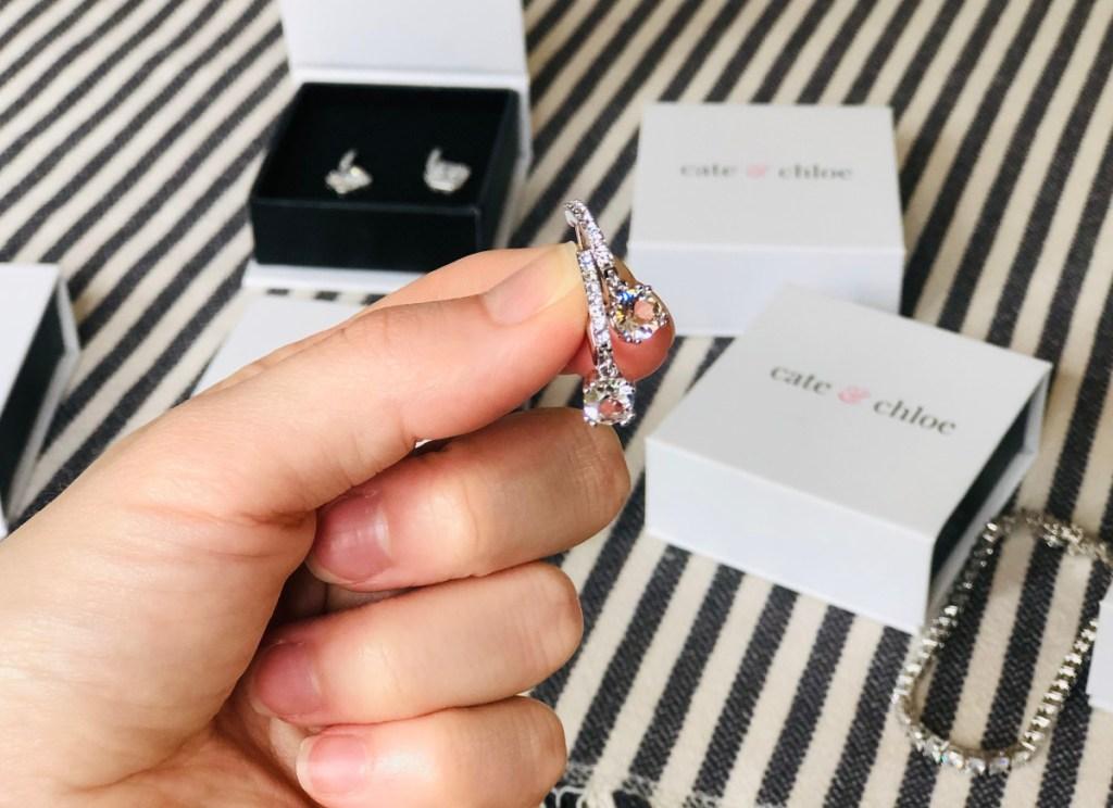 hand holding mckenzie cate & chloe jewelry