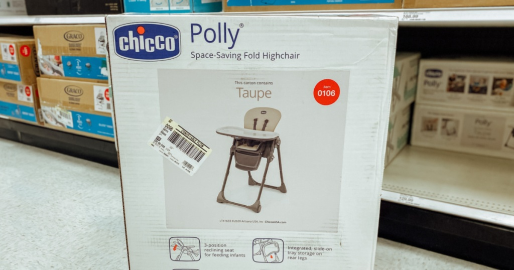 white box with baby high chair on floor