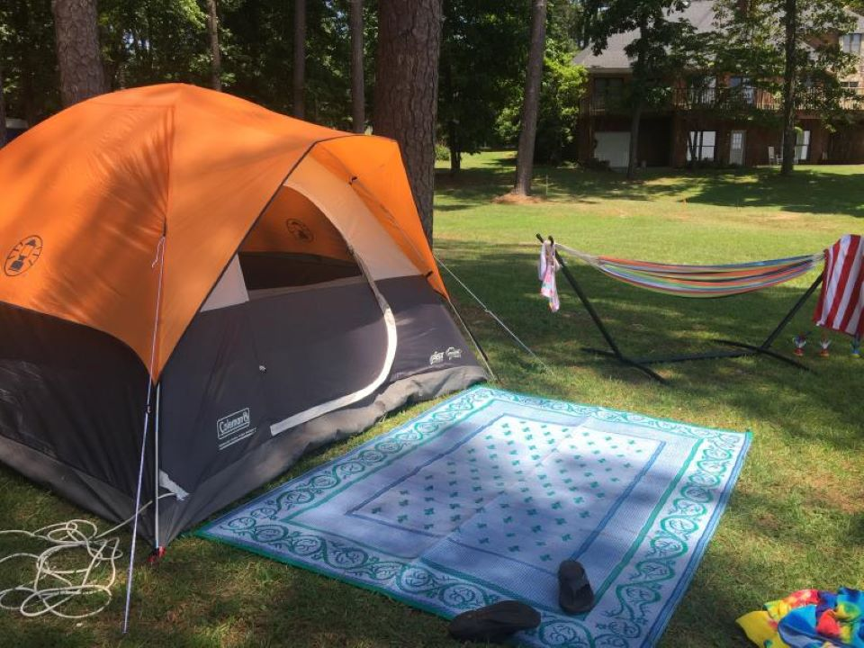 tent with blanket in front of it