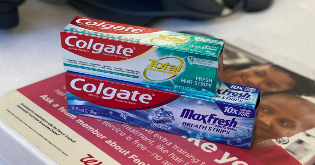 two boxes of toothpaste on store checkout counter