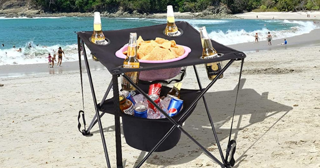 collapsible cooler table on a beach
