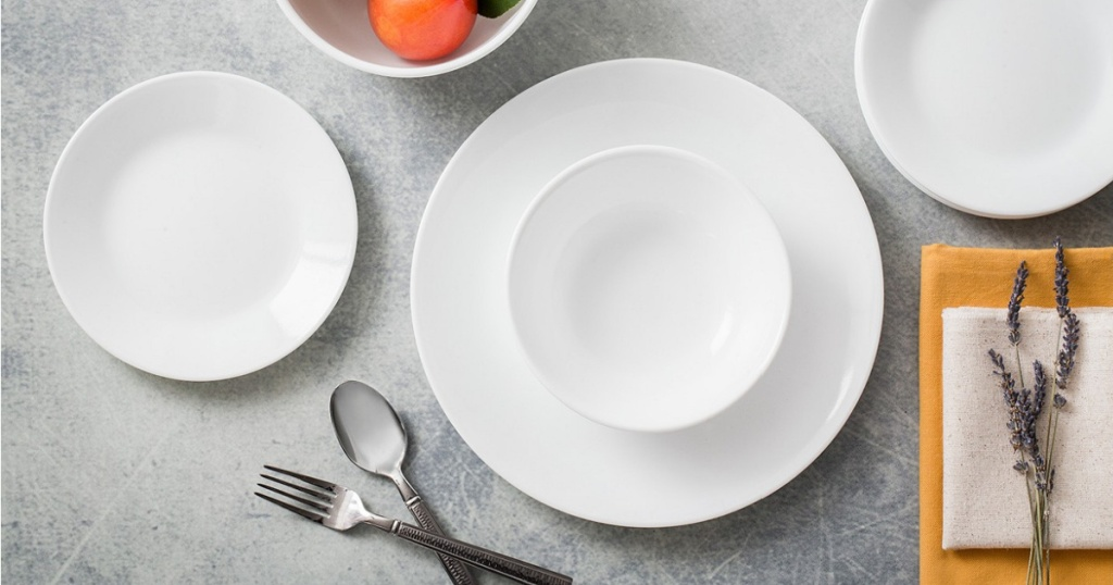 table set with all white dinnerware