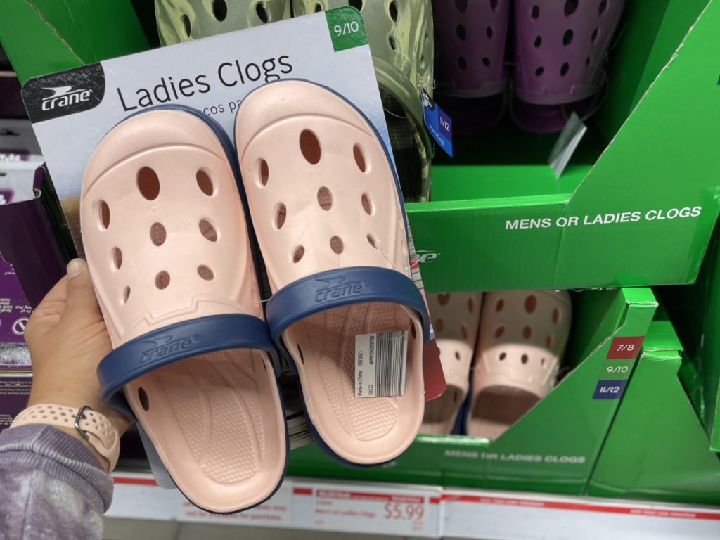 women's pink clogs in packaging near in-store display