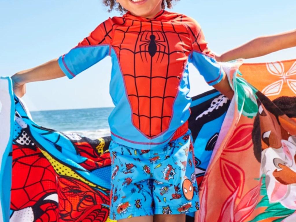 little boy wearing spiderman swimwear