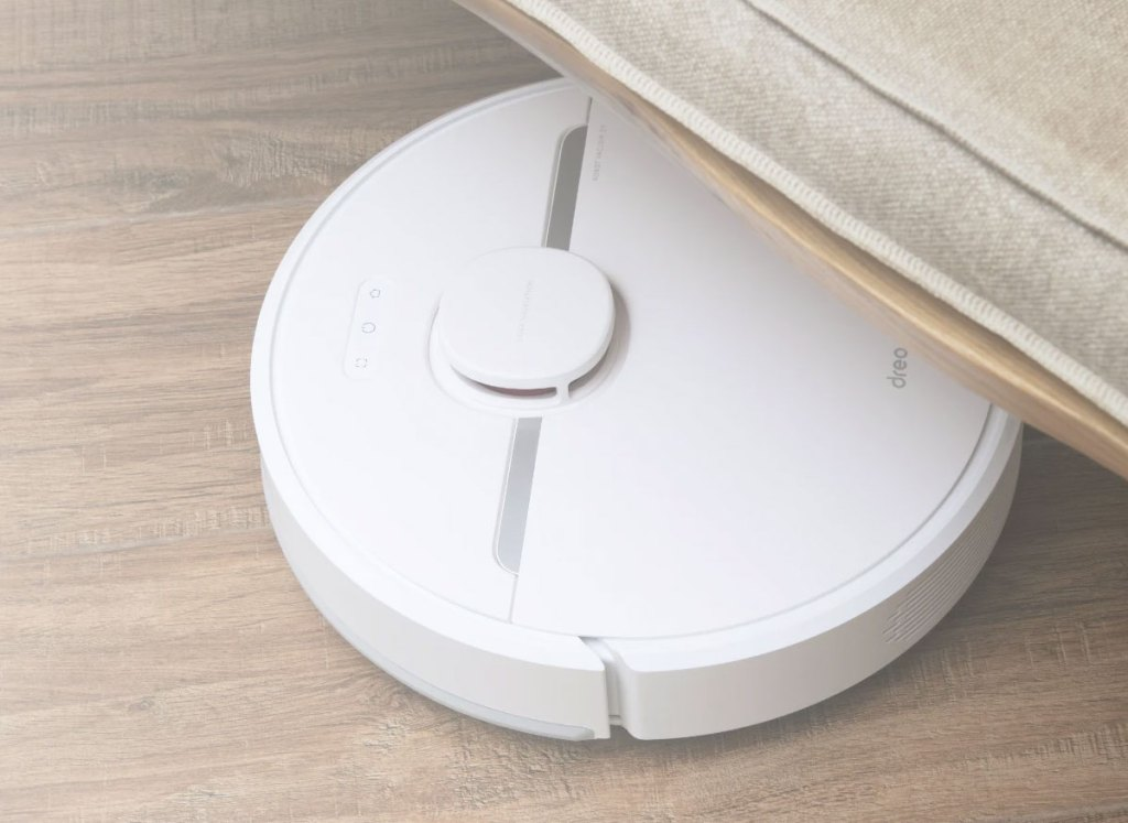 white robot vacuum under a couch