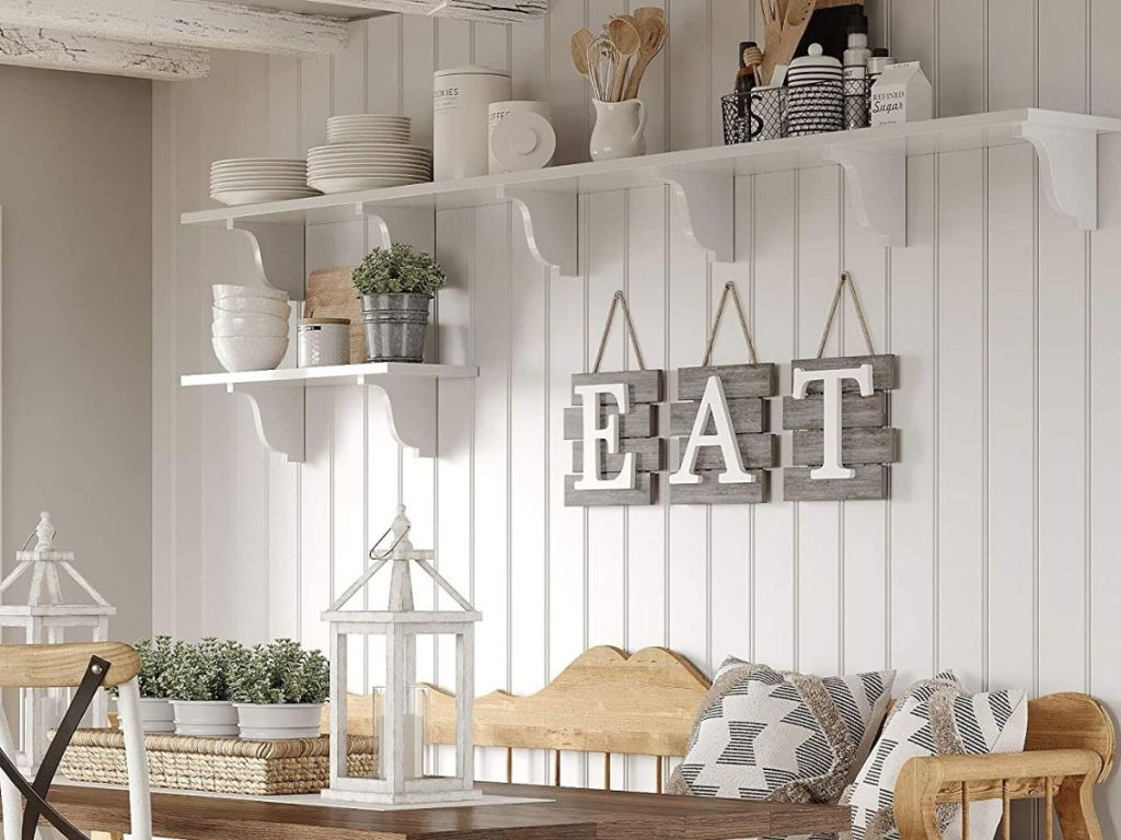 E A T sign hung on dining room wall
