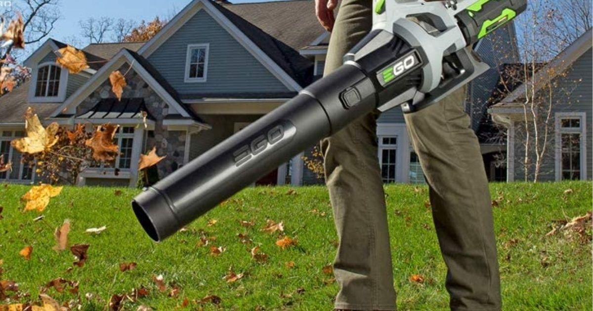man using leaf blower on lawn
