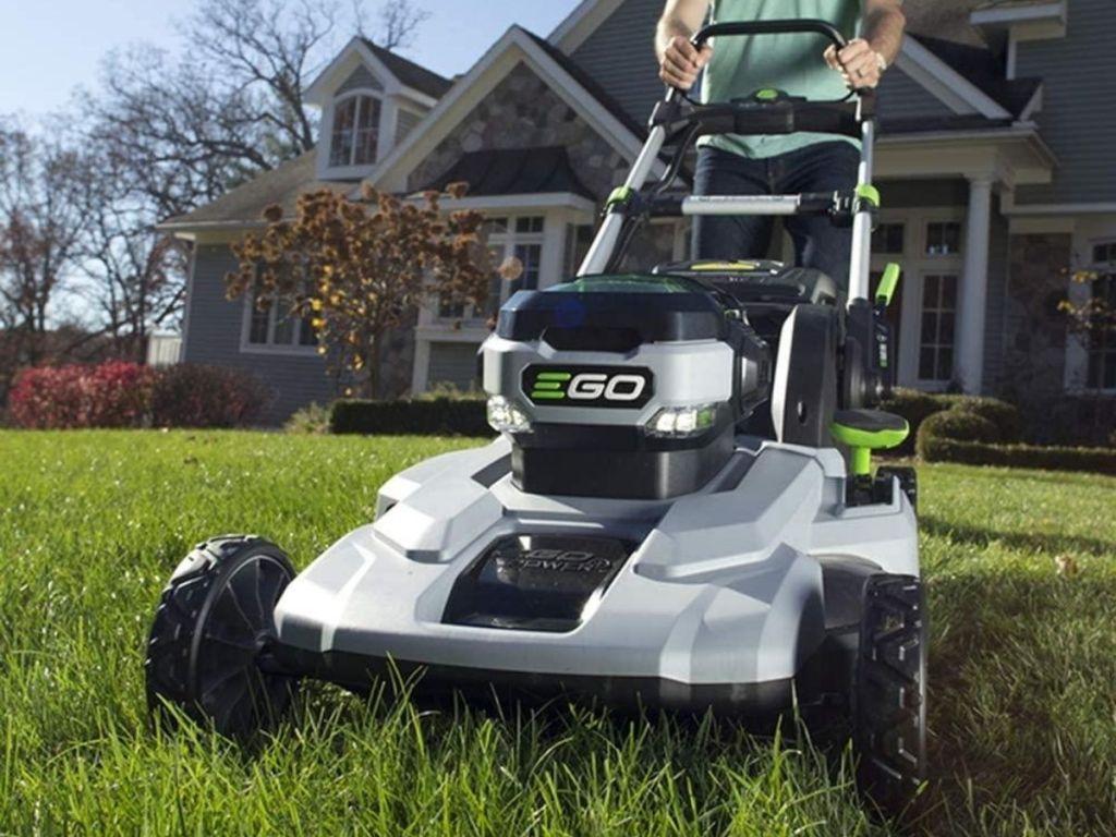 man pushing EGO lawn mower