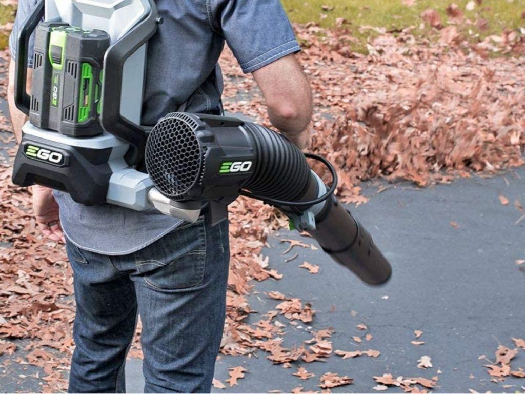 man wearing leaf blower backpack