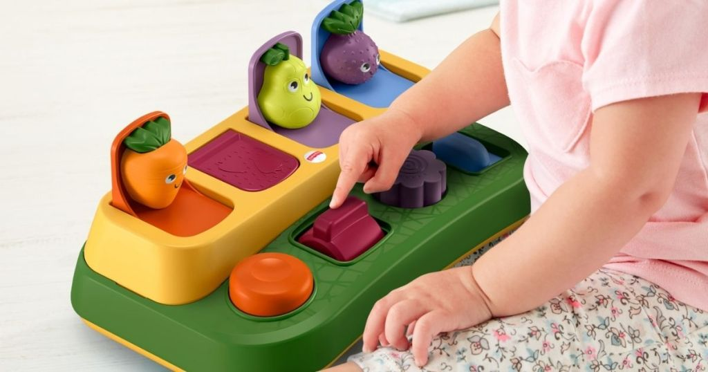 baby playing with Fisher Price Tiny Garden Pop up Surprise
