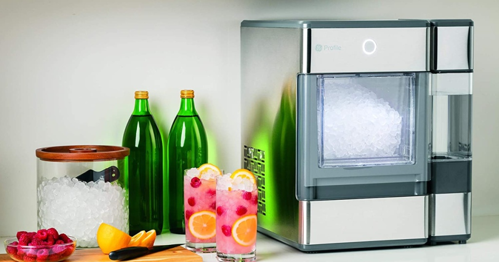 large ice maker next to drinks and glasses