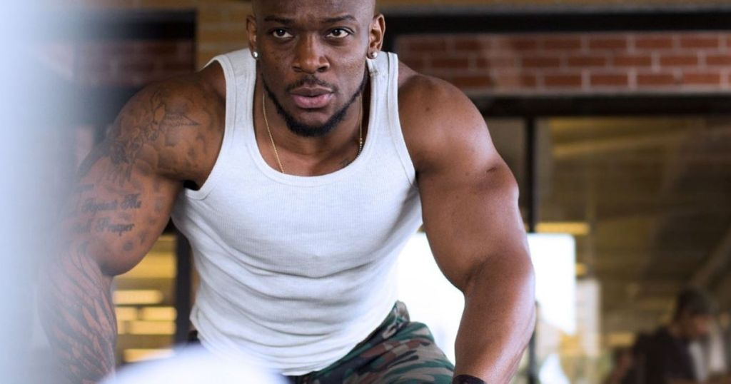 man working out in a tank top