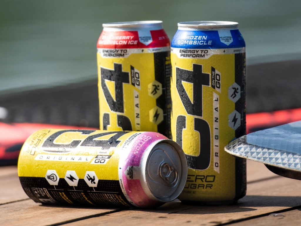 three energy drinks on outdoor table