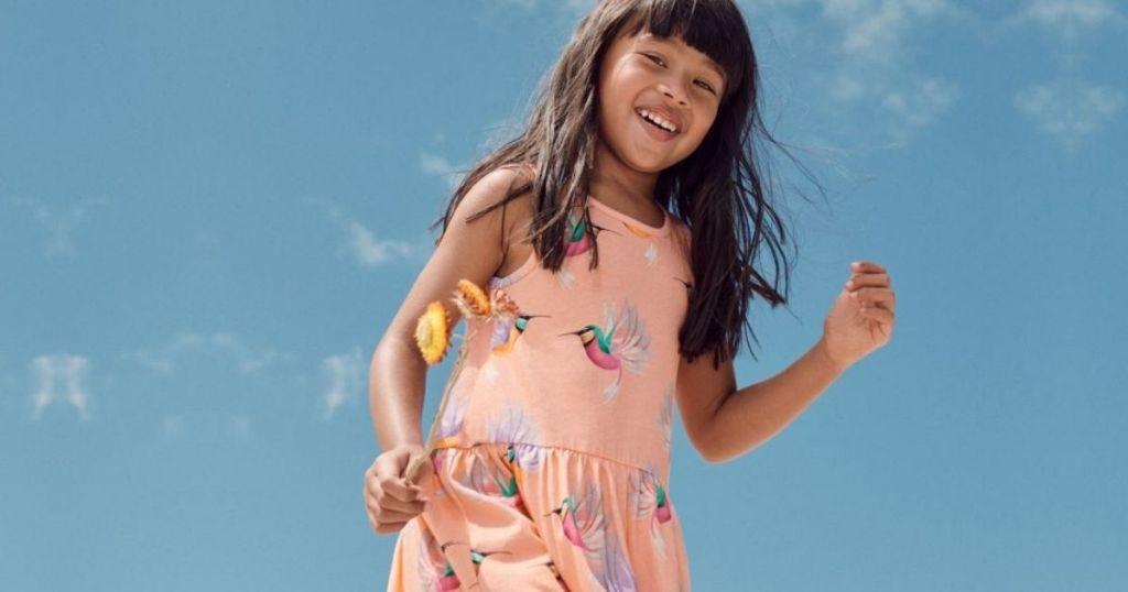 little girl outside wearing a dress