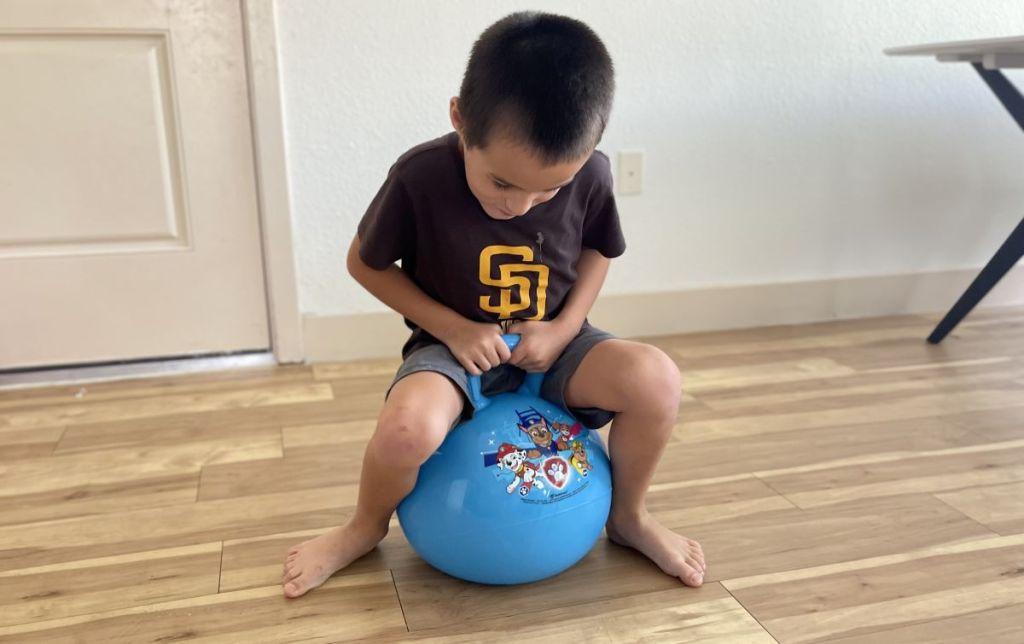 boy on a hopper toy