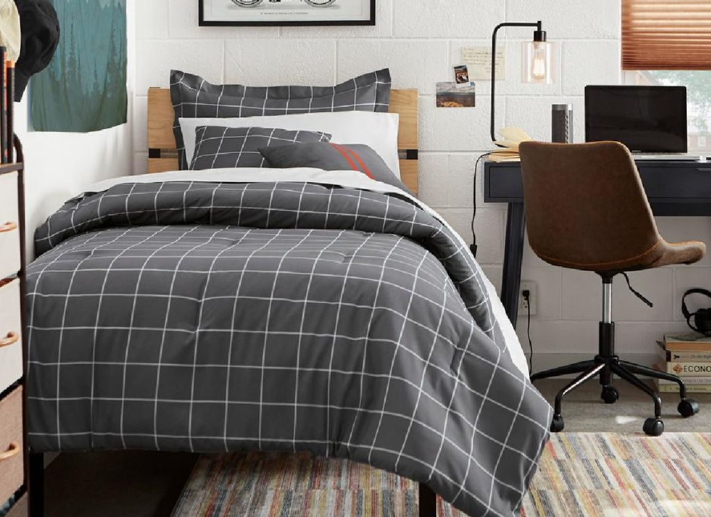 twin platform bed with grey plaid bedspread in boys room