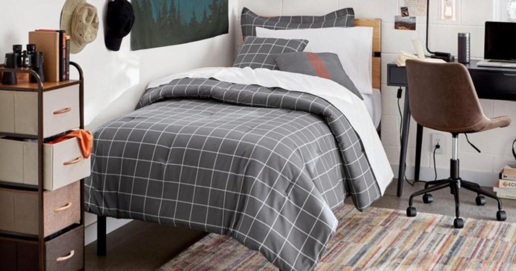 twin platform bed with grey plaid bedspread
