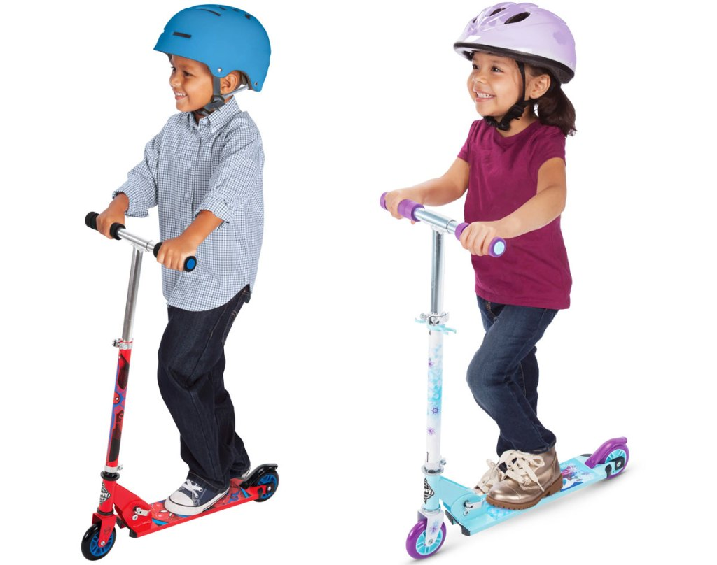 two kids riding on scooters