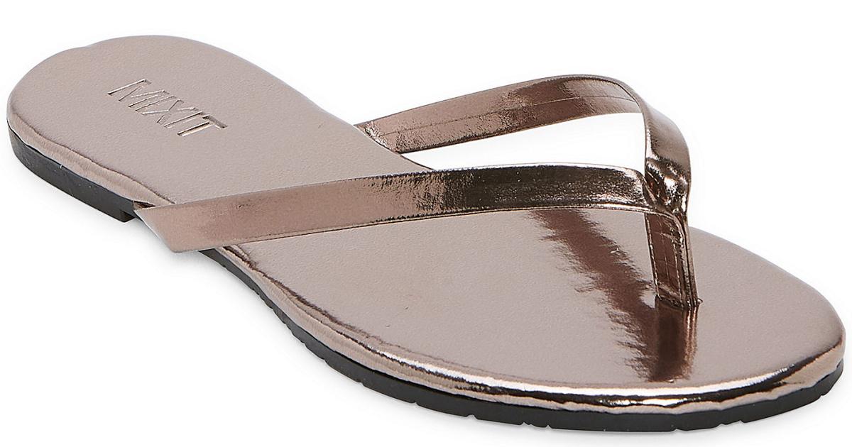 shiny brown flip flops