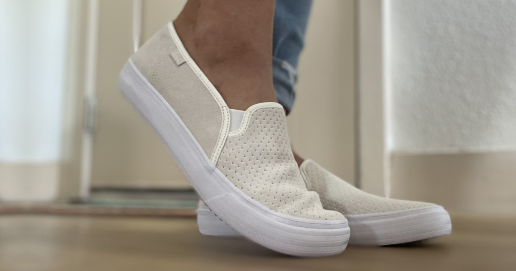 woman wearing a perforated sneakers