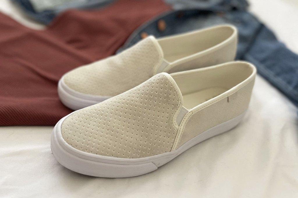 pair of white slip on sneakers