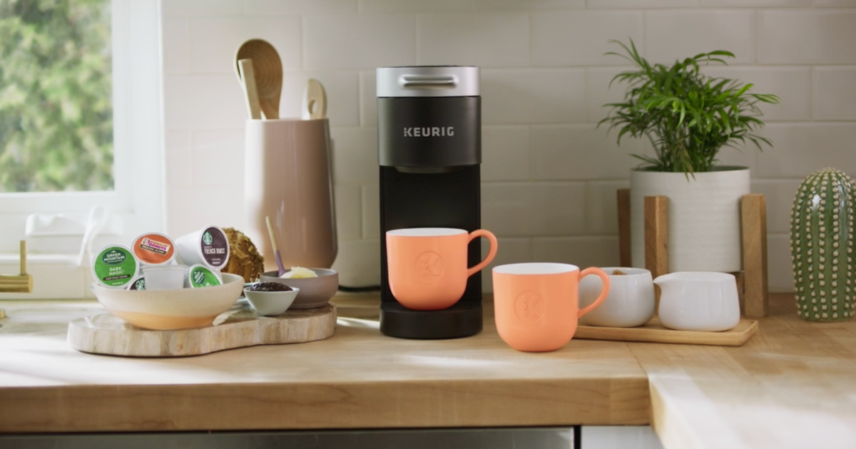 Keurig Slim Coffee Maker on counter with coffee cups