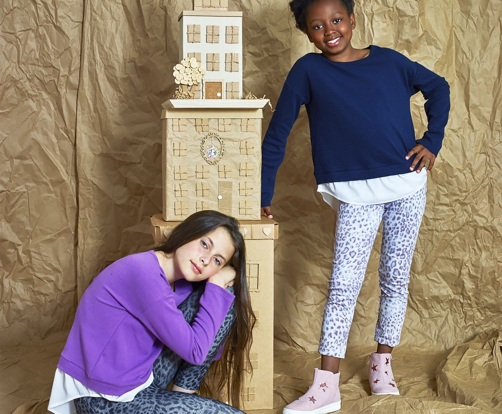 two girls by a tower of blocks