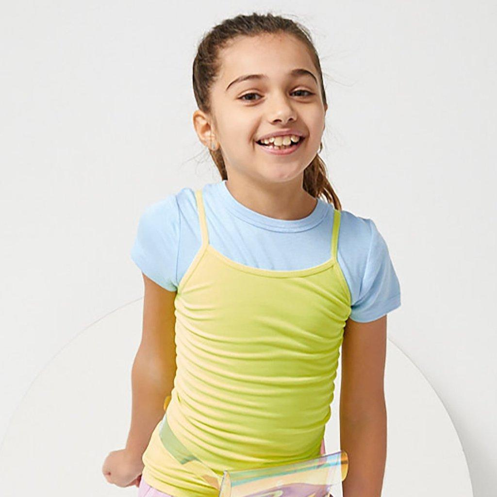 girl wearing a tank and tee