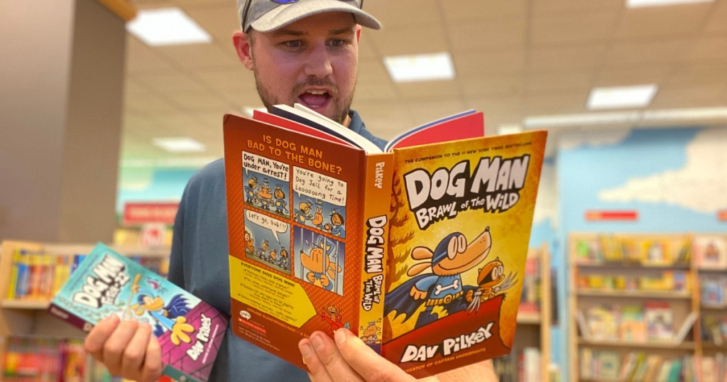 man holding a dog man book