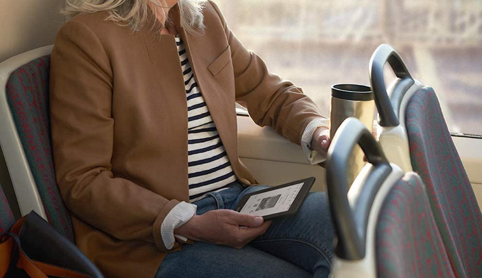 woman holding a kindle paperwhite