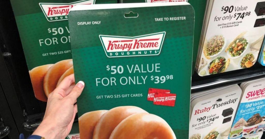 hand holding a Krispy Kreme gift card