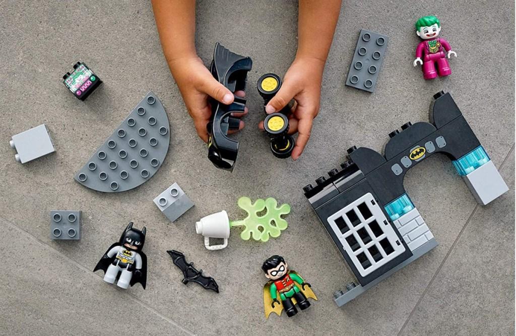 kids hands building a Batman LGO set